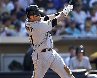 Pittsburgh Pirates' Ryan Doumit launches a grand slam homer against the San Diego Padres in the third inning of a baseball game, Wednesday, May 4, 2011, in San Diego.