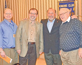 Bob DiBiasio, vice president of public relations with the Cleveland Indians Baseball Team, third from left, was a hit when he spoke about the team and fielded questions during a recent meeting of the Kiwanis Club of Youngstown. He reported on the Tribe's exciting start to the 2011 season, on the return of Grady Sizemore and of special events planned by the team. Joining the speaker following his talk are, from left, Robert Gardner of Stifel Nicolaus Private Client Group, Thomas John from Clear Channel Radio and Chuck Whitman, president of the Kiwanis Club. The organization meets at noon Fridays at the downtown Y.