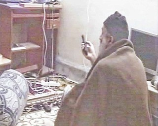 In this undated image taken from video provided by the U.S. Department of Defense, a man who the American government says is Osama bin Laden watches television in a video released on Saturday, May 7, 2011. The videos show bin Laden watching himself on television and rehearsing for terrorist videos.
