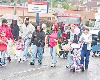 Despite a bit of drizzle, people of all ages walked down Market Street in Youngstown on Saturday morning for the Unity in the Community parade.