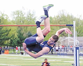 Austintown Fitch junior jumper Jay Jakovina clears the high-jump bar at 6-foot-8 to win the gold medal in the event at the 31st-annual Optimist meet at Fitch's Falcon Stadium. Mahoning Valley athletes earned top-three  finishes in 32 events.