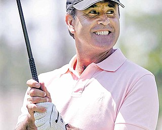 In this May 18, 2007, AP FILE PHOTO, Seve Ballesteros of Spain smiles before teeing off  during the Regions Charity Classic at the Robert Trent Jones Golf Course in Hoover, Ala. Ballesteros died early Saturday at his home in Pedrena in northern Spain from complications of a cancerous brain tumor. He was 54.