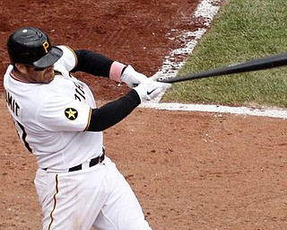 Pittsburgh Pirates' Ryan Doumit (41) hits a three-run home run off Houston Astros pitcher Fernando Abad in the eighth inning of a baseball game in Pittsburgh, Sunday, May 8, 2011. The Pirates won 5-4.