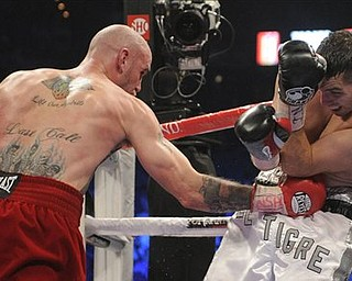 Kelly Pavlik lands a punch to the body against Alfonso Lopez in the fourth round during a WBO World super bantamweight title bout, Saturday, May 7, 2011, in Las Vegas. Pavlik won by unanimous decision.