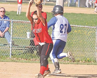 Struthers' Mandy Ditman catches the ball before Hubbard's Brittany Lunt can make it to the bag during Monday's sectional opener in Hubbard.