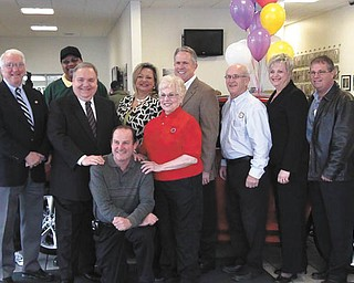Representatives of the Rotary Club of Canfield, Hospice of the Valley, Greenwood Chevrolet of Austintown and General Motors of Lordstown , who are helping with a raffle for a 2011 Chevy Cruze LTZ, are, standing from left, Gerry Finch, Tom Pauley, Marshall Coney Jr., Dante Zambrini, Liz McGarry, Dee Saunders, Greg Greenwood, Jack Saunders, Lynn Roman, Bill Hendricks and Craig Olson., and seated, Tom Mock.