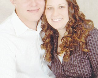 Adam J. Grund and Christy A. Helsel