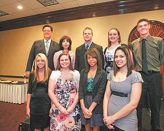 John and Denise DeBartolo York awarded $48,000 in scholarships to eight Mahoning Valley high-school seniors in memory of DeBartolo York's father, Edward J. DeBartolo Sr. The scholarships were presented Tuesday at the Holiday Inn in Boardman. Recipients are, front row, from left, Danielle Strong of Boardman, Lydia Althouse of United Local, Michelle Jones of Lordstown and Tiffany Colon of Campbell Memorial; back row, from left, John and Denise DeBartolo York, Shane Organ of Columbiana, Hayley Herrera of Jackson Milton and Tyler Stimpert of Ursuline. The eighth recipient, Davina Groover of Hubbard High School, isn't pictured.