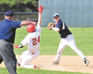 Leetonia shortstop Nick Altomare throws to first base after retiring Columbiana baserunner Bryce Miner during Tuesday's tournament game at Firestone Park. The Clippers won, 7-1.
