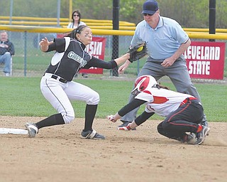 Erin Gilmour, right, of Youngstown State slides under the tag of Green Bay's Sara Junion during a game this spring at McCune Park. Gilmour was one of three seniors on the Penguins' team this season that finished with a 22-24 record, but missed the Horizon League tournament.