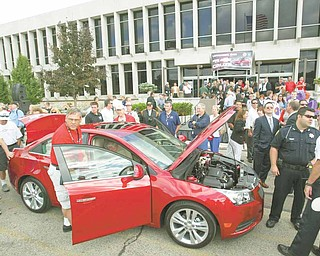 ROBERT K. YOSAY | THE VINDICATOR..people swarm the new  Cruze - GM Lordstown  Kicked Off the Chevy Cruze today at the Lordstown Plant  with the President of GM - Tim Ryan - The Boardman Band and a slew of elected officials -..-30-..