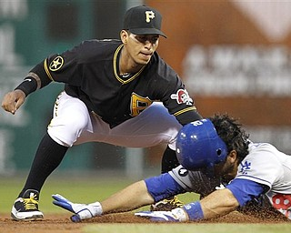 Pittsburgh Pirates shortstop Ronny Cedeno puts the tag on Los Angeles Dodgers' Rod Barajas, who attempted to stretch a fifth-inning single during a baseball game in Pittsburgh on Tuesday, May 10, 2011.