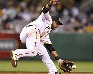Pittsburgh Pirates third baseman Pedro Alvarez fields a grounder by Los Angeles Dodgers' Rod Barajas during the eighth inning of a baseball game in Pittsburgh on Monday, May 9, 2011. Alvarez made the throw to first to record the out. The Pirates won 4-1.