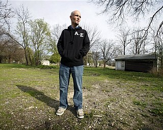 In this May 5, 2011 photo, Justin Van Fleet stands at the site of where his home once stood before the flood of 2008, in Cedar Rapids, Iowa. Van Fleet is among thousands who have received letters in recent weeks from the Federal Emergency Management Agency notifying them they received too much money from the agency dating back to 2005 and now must pay it back.