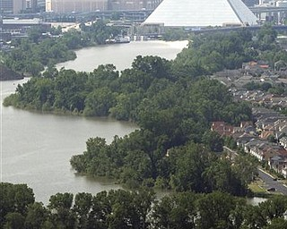 Water from the flooded Mississippi River rises close to the Pyramid in downtown Memphis, Tenn., Monday, May 9, 2011.
