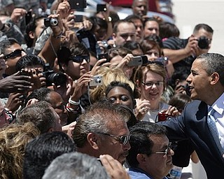 President Barack Obama shakes hands with soldiers and their family members upon his arrival to Biggs Army Airfield in El Paso, Texas where the president will address a small crowd at the Chamizal National Park on the subject of immigration reform, Tuesday, May 10, 2011.