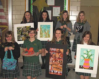 Winning works exhibited: The Alliance for Young Artists & Writers, a nonprofit organization dedicated to recognizing the nation's outstanding teen artists and writers, named the winners of its 2011 awards following a local scholastic art show hosted by Youngstown State University at the McDonough Museum. Eighth-grade students from Holy Family School in Poland receiving awards were, from left in front, Kayleigh Burke, Silver Key; Alexis Ohlin, Honorable Mention; Mackenzie Wardle, Gold Medal; and Danielle Wainio, Honorable Mention, and in back, Mackenzie Metzinger, Silver Key; Olivia Proia, Silver Key; Hallie Yerian, Gold Medal; and Marisa Stephenson, Silver Key. Since 1923 the organization has recognized more than 13 million teen artists and writers in grades 7 through 12, who submitted their work in more than 25 categories, including film and animation, video game design, poetry, sculpture, fashion design, journalism, photography and science fiction.