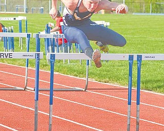 Miles Dunlap of McDonald High School clears a hurdle on his way to winning the boys 110-meter hurdles event during the Inter Tri-County League Tier 2 track meet Wednesday at Western Reserve High School in Berlin.