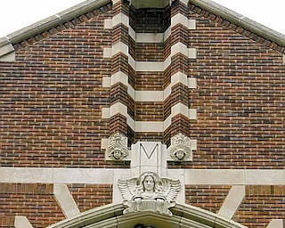 The edifice of St. Patrick Church, 1420 Oak Hill Ave., Youngstown, reaches toward heaven with a cross flanked by two angels. The brick and stone church in a Gothic design was dedicated in 1926. The first church was a California mission-style built in 1911.
