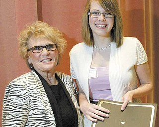 Megan Chambers, who graduates next month from Boardman High School, poses with Cynthia Anderson, Youngstown State University president. Chambers is one of a new group of Leslie H. Cochran University Scholars recognized Friday at YSU.