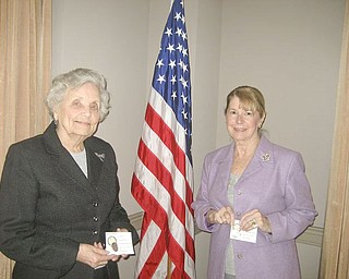 Gold pins, signifying 50 years of service to the Youngstown Area Federation of Women's Club, were awarded at a recent meeting of the club to, from left, Lucile Bartelmay and Barbara Higgins.