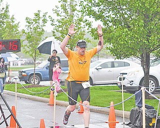 Victor Cushnick, 43, crosses the finish line at the Davis Family YMCA/ Steel Valley Tri Club Spring Distance Triathalon.
