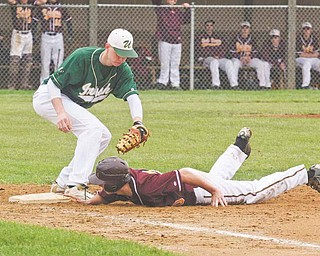 South Range's Cory Deal (20) makes it safely back to the bag ahead of the tag by Ursuline's John McGeary (18)  during their Division III sectional final Monday at Cene Park in Struthers. After leading 5-4 in the top of sixth,  the Raiders gave up two runs in the bottom of the inning to give the Irish the 6-5 win.