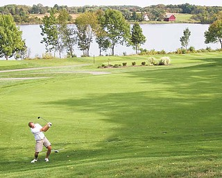 Dick Marlowe, Tippecanoe Country Club, hits to the 18th green at The Lake Club during last year's inaugural Greatest Golfer of the Valley tourney. The 2011 finals will be played at Lake on Sunday, Aug. 28.