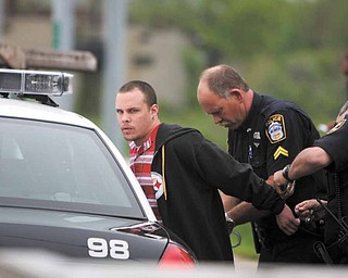 Police arrested Aaron Freet, one of two suspects in a burglary of a Beaver Township home. The suspects led police on a chase Monday morning that traveled through parts of Beaver, Springfield and Poland townships and Struthers before ending when the car crashed in Youngstown.