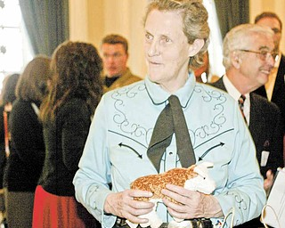 Temple Grandin greets guests at the reception before her Tuesday night speech at a sold-out Stambaugh Auditorium. The animal scientist and author talked about her career in the livestock industry, her life with autism and other topics.