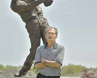 Paul Otto stands in front of a statue at the entrance of Kennsington Golf Club in Canfield. Otto, the third  general manager of the course in as many years, has been around golf since he was eight — 50 years ago.