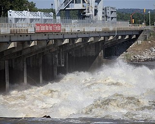 Water from the Mississippi River roars through the Old River Control Structure towards the Atchafalaya Basin in Concordia Parish, La., Tuesday, May 17, 2011. The structure's gates were opened to help relieve rising floodwaters from the Mississippi.