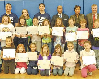 Girl Scouts of Troop 80344, McDonald, show off their individual certificates after receiving the Silver Level President's Volunteer Service Award for community service.