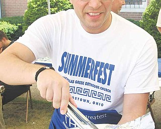 Ted Karabatsos of Canfield makes a Gyro at the St. Nicholas Greek Summerfest.