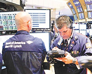 In this May 16, 2011 photo, traders work on the trading floor of the New York Stock Exchange. World stocks climbed Wednesday, May 18, shrugging off weak U.S. economic indicators as Asia got a boost from signs that Japan's post-tsunami recovery is quickening.