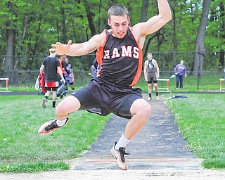 Mike Keleman of Mineral Ridge launches off  the springboard in the boys long jump final of the Division III track meet. Keleman's jump of 20-1 1⁄2 put him in third place. He and teammate Dan Skiba, who won the event, qualified for the regional meet.