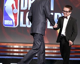 NBA deputy commissioner Adam Silver, left, congratulates Nick Gilbert, 14, the son of Cleveland Cavaliers owner Dan Gilbert, after it was announced that Cleveland won the 2011 NBA basketball draft lottery, Tuesday, May 17, 2011 in Secaucus, N.J. Nick Gilbert was the on-stage representative for the team during the drawing announcement.