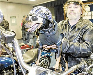 Trace Insley, a GM Lordstown employee from Austintown, and his dog, Buddy, were among a group of more than 30 motorcyclists participating Thursday in the 15th annual GM Lordstown Bike Show. The event raised money for the March Of Dimes.