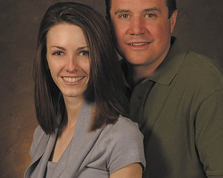 Lauren J. Hake and George N. Roman IV