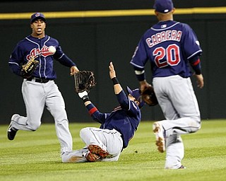 Cleveland Indians' right fielder Shin-Shoo Choo, center, catches a ball between teammates Orlando Cabrera, right, and Michael Brantley in the eighth inning of a baseball game against the White Sox on Wednesday, May 18, 2011. The White Sox won 1-0.