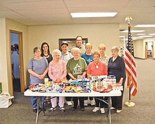 The members of Austintown Senior Center recently donated and shipped care packages for troops overseas. Lucy Caruso, a Youngstown State University student intern at the center, organized the collection and shipment of the donated items. She has a brother serving with the Marines in Afghanistan. In the front row, from left to right, are Joann Lipkovich, Dorothy Schultz, Faye Marciano, Roselynn Ferranti and Mary Sponagle. In the back row are Caruso; Alex Panno; Bill Adams, director of the senior center; Ruth McAndrews and Jeannette Hitt.