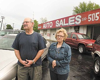 Russ and Maria Nardo, at Nardo's Auto Sales in Niles, are suffering partly as a result of the lack of high-quality used cars, which are in high demand. Russ Nardo said he's sold one car so far this month.