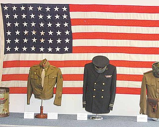 These military uniforms are part of a display at the World War History & Art Museum on East State Street in Alliance. The museum officially opens Saturday.