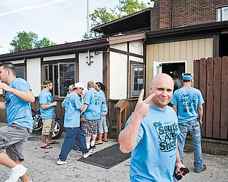 Crowds gather outside of East Side Civics as some patrons wait for rides home and others plan their next stop along the shuffle Saturday. Proceeds from this year's shuffle will benefit the Multiple Sclerosis Society.