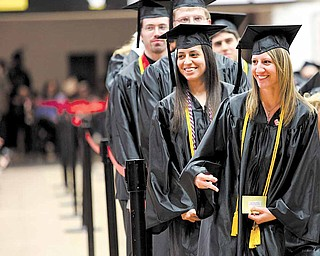 Janna Wheeler, right, of Carrollton and Deanna Zamudio of Berlin Center pose for a photo before accepting their bachelor's degrees during YSU commencement ceremonies Saturday morning in Beeghly Center. Both majored in studio art.