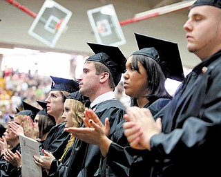 Graduates applaud as Jamail Johnson's family accepts his posthumous degree during YSU commencement ceremonies Saturday morning in Beeghly Center. Johnson, a YSU senior, was killed Feb. 6 in a shooting near the campus.