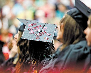 A graduate shows off  her decorated mortarboard during YSU commencement ceremonies Saturday morning  in Beeghly Center.