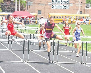 Mooney's Chyna Davis leads the field on her way to a win in the  girls 100-meter hurdles at the Division II district track meet Saturday at Salem High School.