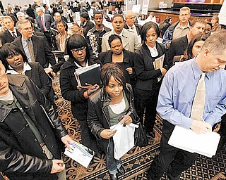 In this Nov. 4, 2009, file photo, job seekers attend a job fair in Livonia, Mich.  Some states that have drained their unemployment insurance funds are cutting the number of weeks that a laid-off worker can count on those benefits. Michigan, Missouri and Arkansas recently reduced the maximum number of weeks that the jobless can get state unemployment benefits, and Florida is on the verge of doing so. Unemployment in those states ranges from 7.8 percent in Arkansas to 11.1 percent in Florida.