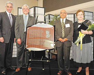 From left, Dr. Jay A. Gershen, president of Northeast Ohio Medical University in Rootstown, and Steven P. Schmidt, chairman of the board, honor Dr. Chander M. and Karen Kohli of Liberty for their gift of $500,000.